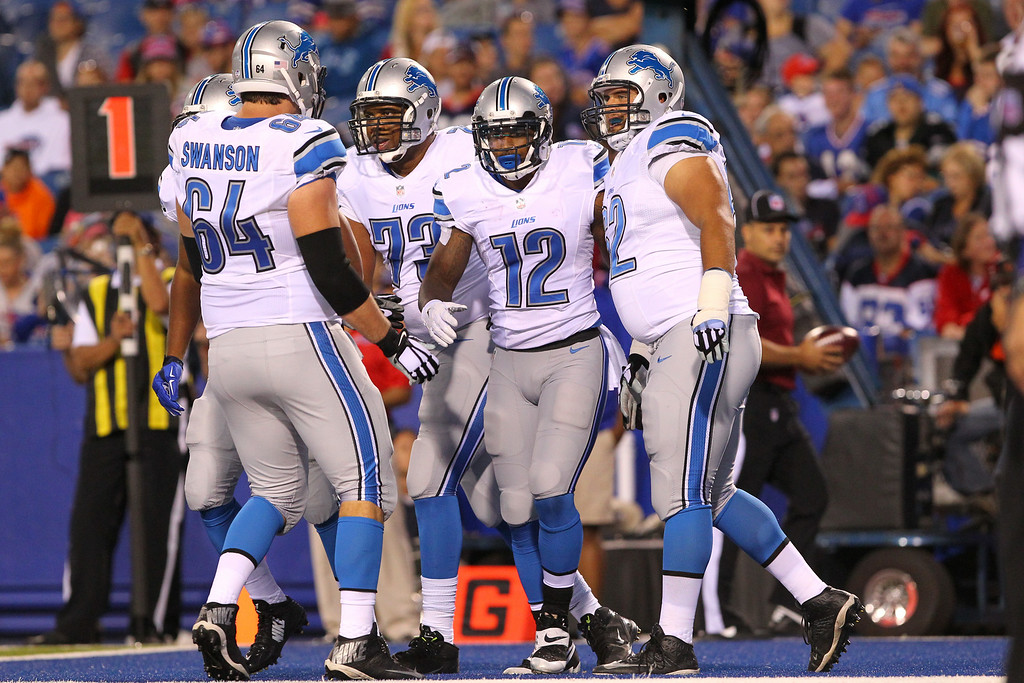 . Detroit Lions wide receiver Jeremy Ross (12) is congratulated by teammates after scoring on a pass from quarterback Kellen Moore during the first half of a preseason NFL football game against the Buffalo Bills, Thursday, Aug. 28, 2014, in Orchard Park, N.Y. (AP Photo/Bill Wippert)