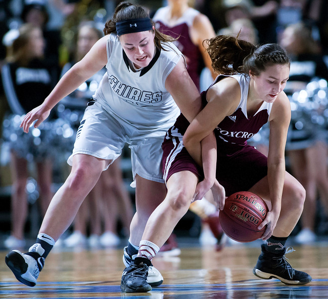 BANGOR, Maine -- 02/25/2017 -- Houlton's Aspen Flewelling (left) and Foxcroft Academy's Kendra Ewer battle for a loose ball during their Class B girls basketball championship game at the Cross Insurance Center in Bangor Saturday. Ashley L. Conti | BDN