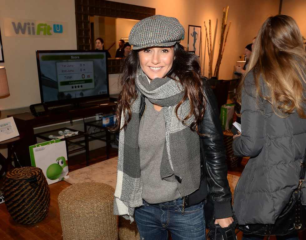 . Actress Emmanuelle Chriqui poses for a picture while Wii Fit U Brings Fun and Fitness to the Nintendo Chalet during the 2014 Sundance Film Festival on January 20, 2014 in Park City, Utah.  (Photo by Jason Merritt/Getty Images for Nintendo)