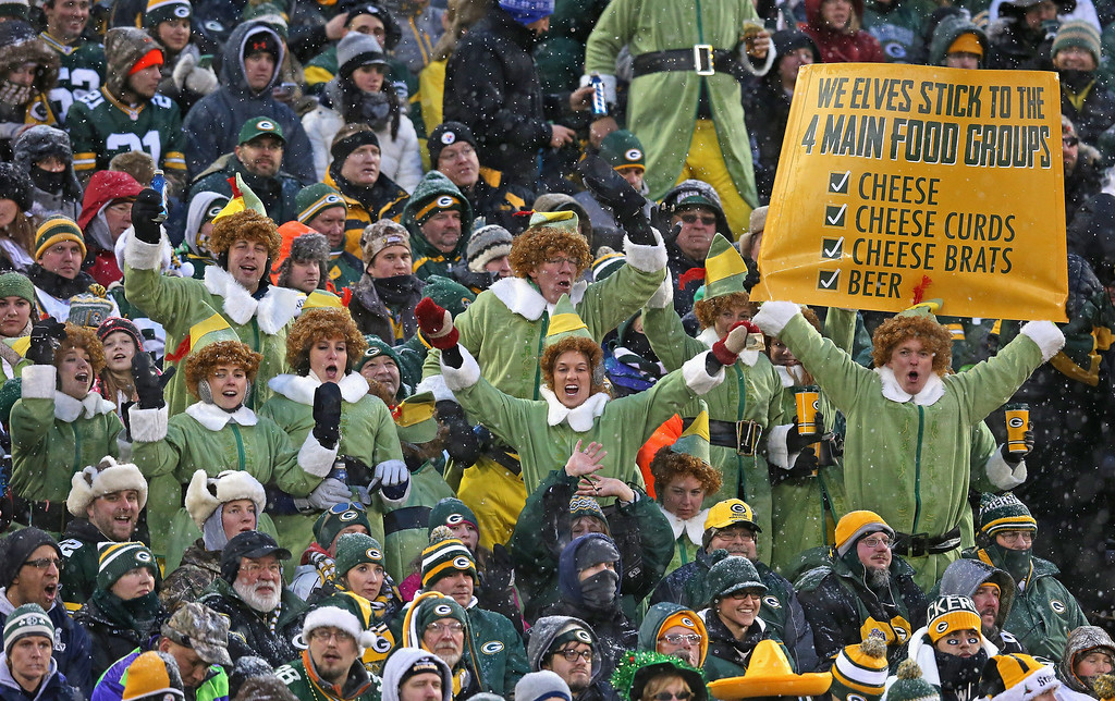. Fans of the Green Bay Packers dressed as elves enjoy a game between the Packers and the Pittsburgh Steelers at Lambeau Field on December 22, 2013 in Green Bay, Wisconsin.  (Photo by Jonathan Daniel/Getty Images)