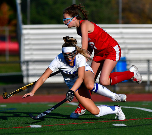 10/15/2019 Mike Orazzi | StaffrSouthington High Schools Jenna Sheehan (11) and Conard's Sarah Gallagher r(10) during a 2-2 tie in Southington on Tuesday afternoon.