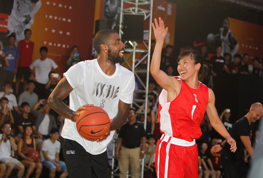 . NBA Cleveland Cavaliers guard Kyrie Irving, gives instructions while he holds a short basketball clinic with young Taiwanese players in Taipei, Taiwan, Saturday, July 22, 2017.(AP Photo/Chiang Ying-ying)