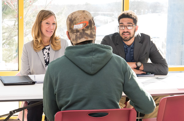 02/13/19 Wesley Bunnell | Staff The New Britain Housing Authority launched a new program on Thursday to help residents with education, financial, mental health and job opportunities. Rebecca Carruthers, L, and Joshua Gilmore of the American Job Center speak with client Angel Alejandro.