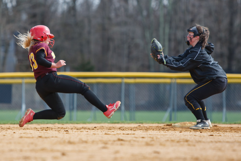 Sheehan's Becca Souze (13) gets caught stealing between second and third by Amity's Cassidy Kirby (4) Thursday at Amity Regional High School in Woodbridge Apr. 23, 2015 | Justin Weekes / For the Record-Journal