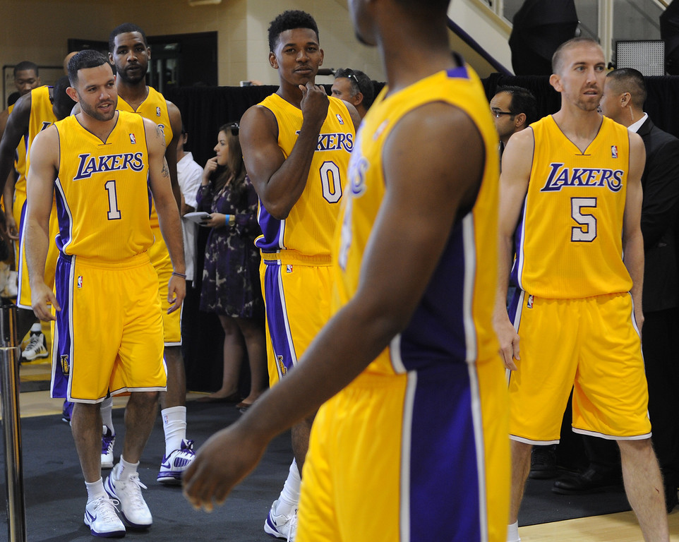 . Lakers #1 Jordan Farmar, #0 Nick Young and #5 Steve Blake enter the practice facility for media day. The Los Angeles Lakers held a media day at their El Segundo practice facility. Players were photographed for team materials, and interviewed by the press. El Segundo, CA. 9/27/2013. photo by (John McCoy/Los An8eles Daily News)