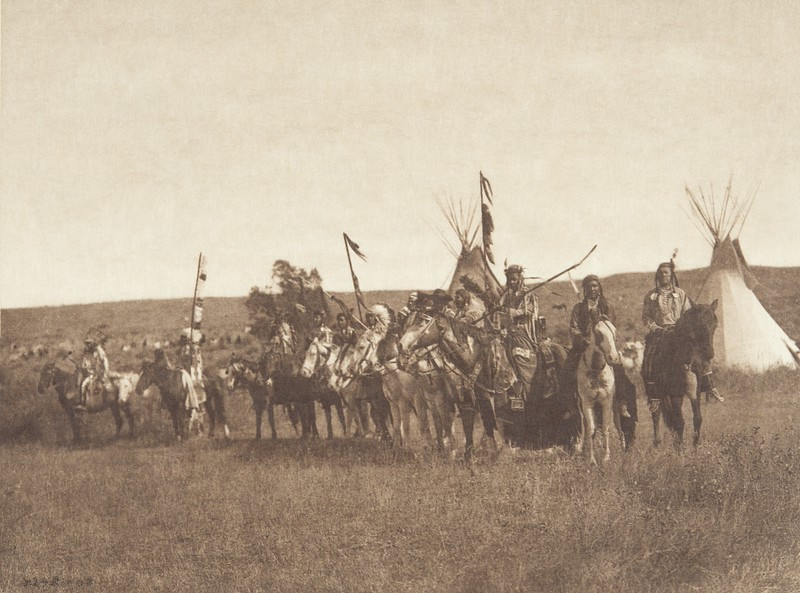 The Parade - Apsaroke (Indians of North America, v. IV. Cambridge, MA: The University Press, 1909)