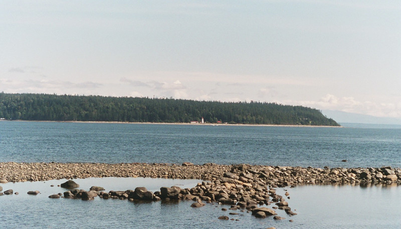 This a view of Quadra Island from the other side of the inside passage - if you look real close, you can see the light house on the other side.