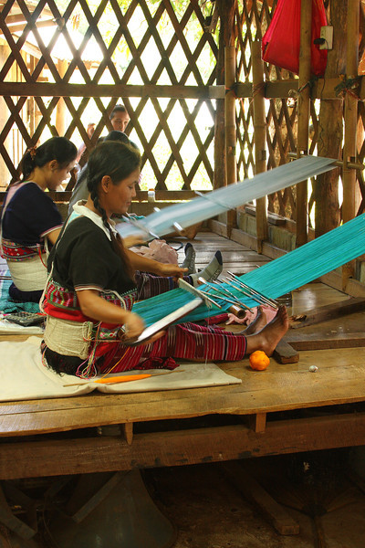 Tribal women weaving