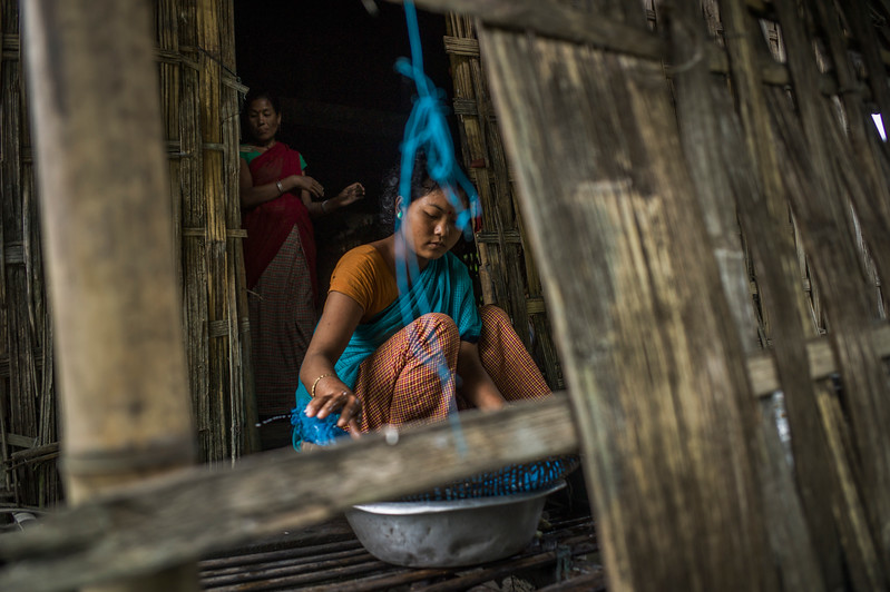 Dhemanji, Assam, India August,2014:   Unmoni Tait(16), married 3 months ago,  seen making local rice beer ( Apong) at her husband's home in Sali Kuchi Village.   Series on early marriages in Assam, India for Al Jazeera America.       Photo:  Sami Siva