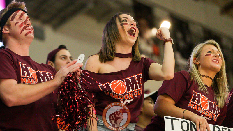 A student in the Cassell Guard cheers as the game tips off. (Mark Umansky/TheKeyPlay.com)