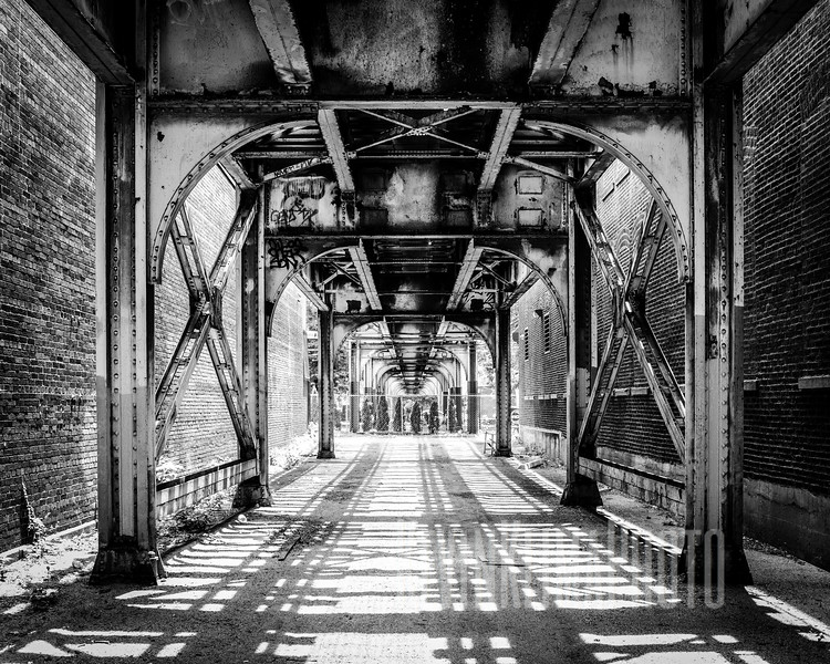 Under the el tracks.
