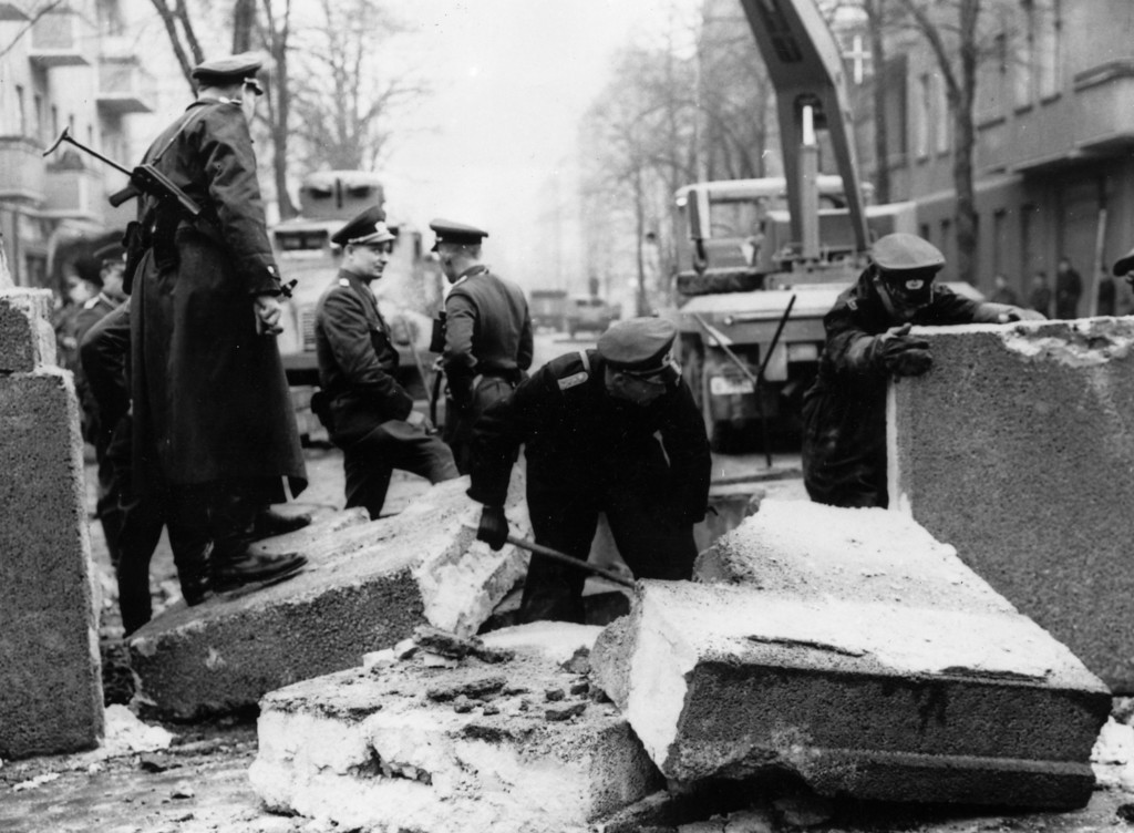 . Officers inspecting the damage to the Berlin Wall, East Germany, and making preparations for its repair, after an East German rammed the Wall with an army car and successfully escaped.   (Photo by Keystone/Getty Images)