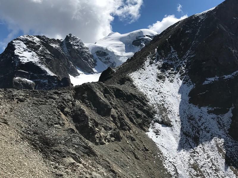 Piz d'Arlas, left; Piz Cambrena with glacier