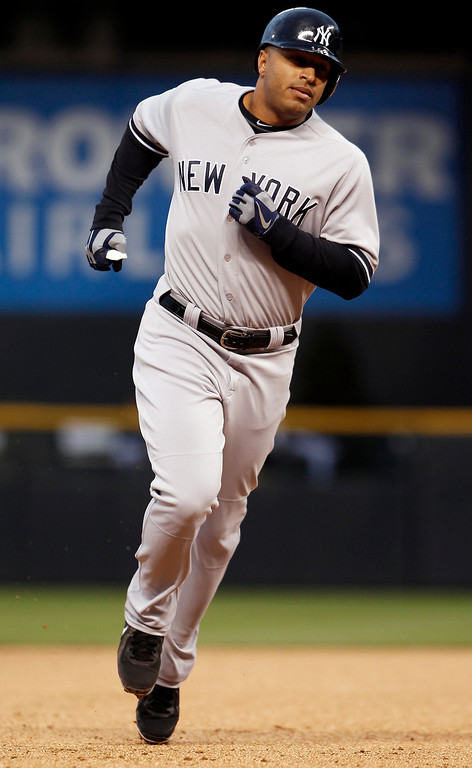 . New York Yankees\' Vernon Wells rounds the bases after hitting a two-run home run against the Colorado Rockies in the first inning of a baseball game in Denver on Wednesday, May 8, 2013. (AP Photo/David Zalubowski)
