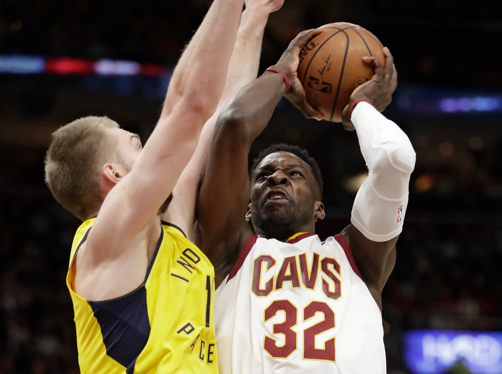 . Cleveland Cavaliers\' Jeff Green (32) shoots against Indiana Pacers\' Domantas Sabonis during the first half of an NBA basketball game Friday, Jan. 26, 2018, in Cleveland. (AP Photo/Tony Dejak)