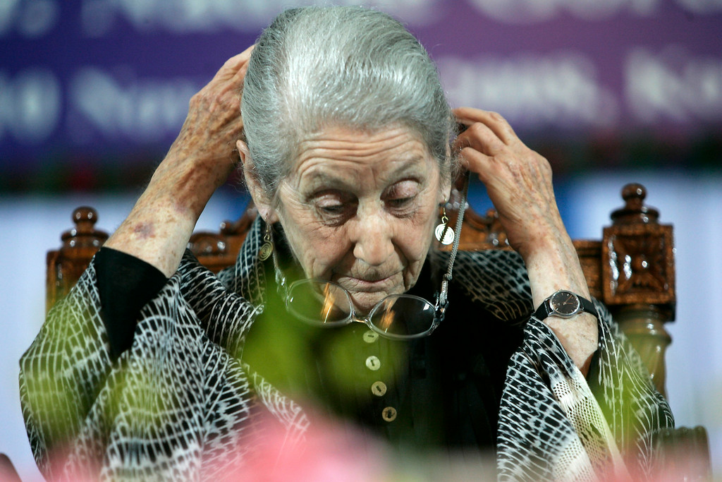 """. South African writer and Nobel laureate Nadine Gordimer, adjusts her glasses before delivering a speech titled \""""The Inward Testimony\"""" in Calcutta, India, Monday, Nov. 10, 2008. Gordimer,is in India on an invitation from the public diplomacy division of the Indian ministry of external affairs.(AP Photo/Bikas Das)"""