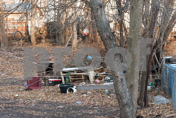 12/06/17 Wesley Bunnell   Staff Trash and other items in the rear of 29 Tremont St in the North Oak Section of New Britain. Residents of the neighborhood have recently been speaking up regarding blight and alleged neglect from the city regarding their concerns.
