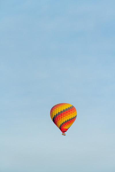A colorful hot air balloon against a clear blue sky