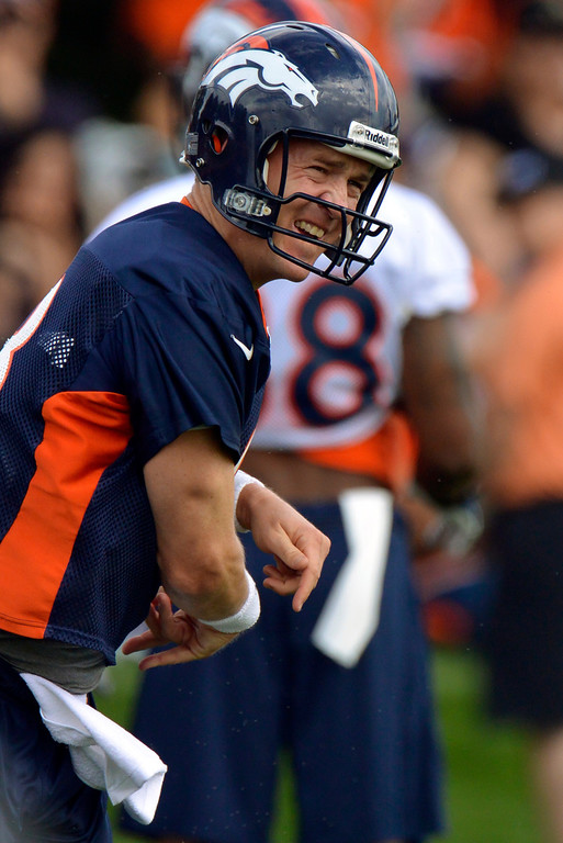 . Denver Broncos quarterback Peyton Manning (18) throws a pass during opening day of training camp July 25, 2013 at Dove Valley. (Photo By John Leyba/The Denver Post)