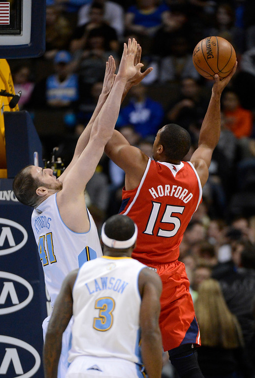 . Al Horford (15) of the Atlanta Hawks takes a shot over Kosta Koufos (41) of the Denver Nuggets March 4,  2013 at Pepsi Center. (Photo By John Leyba/The Denver Post)