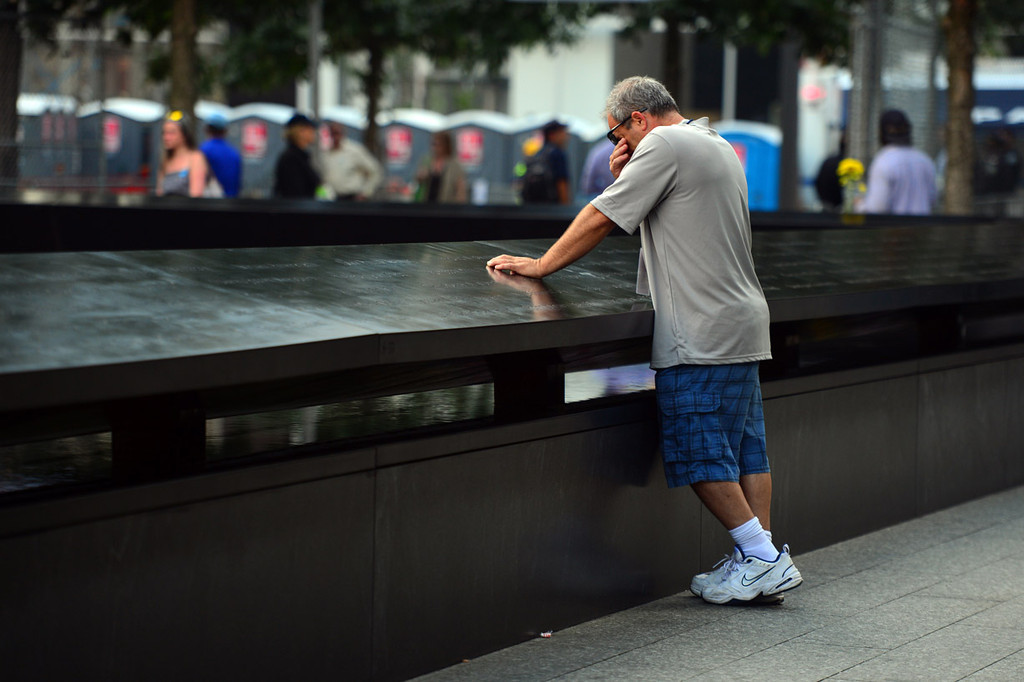 . TJ Neary pauses to remember his mother Mauriel Siskocoulos at the 9/11 Memorial during ceremonies for the twelfth anniversary of the terrorist attacks on lower Manhattan at the World Trade Center site on September 11, 2013 in New York City.  (Photo by Alejandra Villa-Pool/Getty Images)