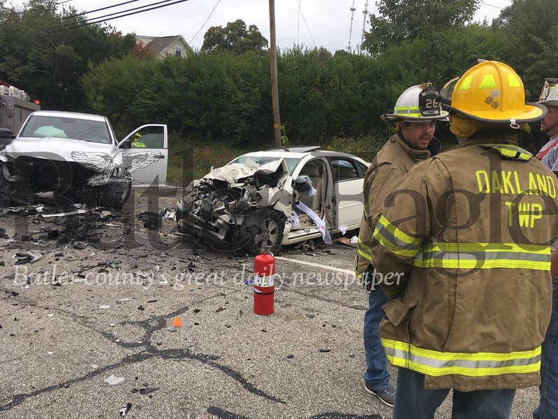 Volunteer firefighters respond to a two-vehicle crash on Route 68 that left both drivers seriously injured in Summit Township.
