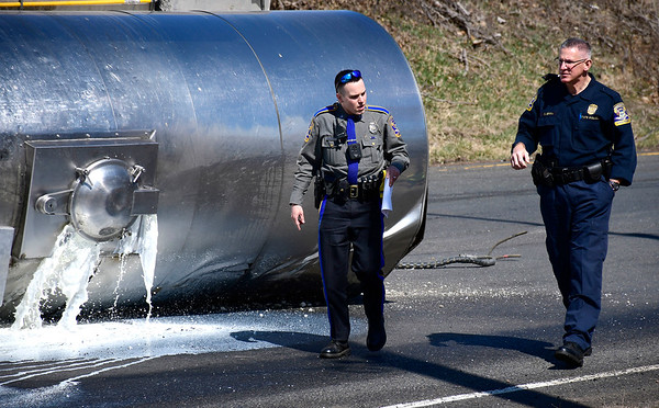 3/18/2020 Mike Orazzi | Staff The scene of a rolled over tanker carrying milk at the entrance to Route 72 at the intersection with Route 177 in Plainville on Wednesday.