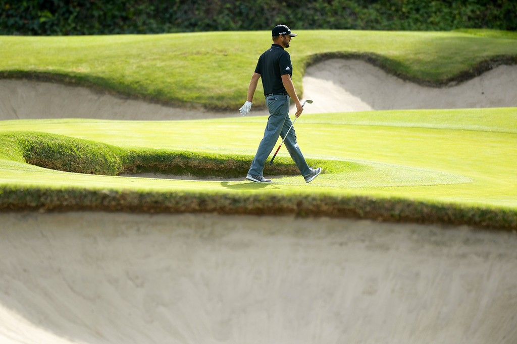 . Blake Adams walks between bunkers on the sixth hole during the third round of the Northern Trust Open, Saturday, February 15, 2014, at Riviera Country Club. (Photo by Michael Owen Baker/L.A. Daily News)