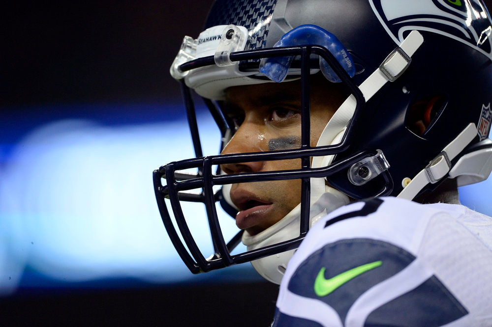 . Quarterback Russell Wilson (3) of the Seattle Seahawks watches the action from the sidelines during the first half.  The Denver Broncos vs the Seattle Seahawks At Sports Authority Field at Mile High. (Photo by AAron Ontiveroz/The Denver Post)