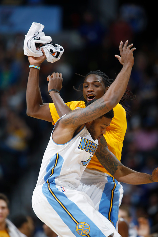 . Denver Nuggets forwards Alonzo Ge, front, and Kenneth Faried celebrate after Gee hit a three-point shot against the Detroit Pistons in the fourth quarter of the Nuggets\' 89-79 victory in an NBA basketball game in Denver on Wednesday, Oct. 29, 2014. (AP Photo/David Zalubowski)
