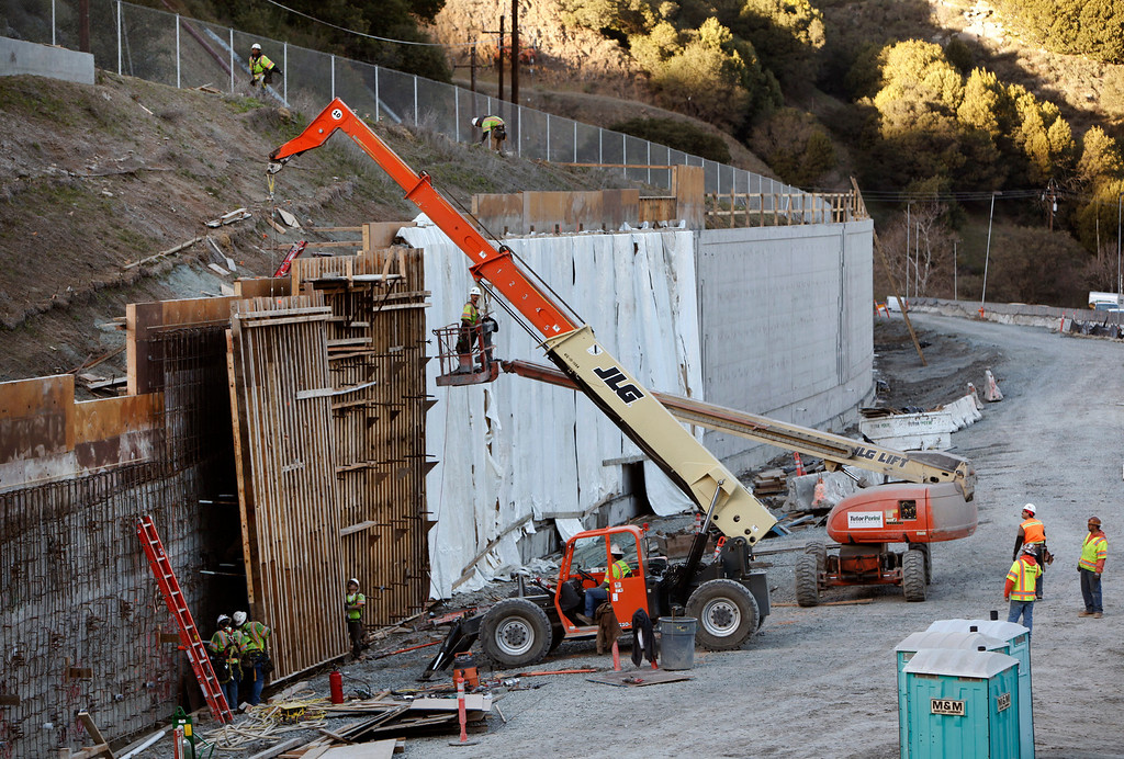 . Construction crews build retaining walls along Highway 24 approaching the East Portal of the Caldecott Tunnel fourth bore project Friday afternoon Jan. 18, 2013 near Orinda, Calif. The long-awaited project expects to open sometime in the latter part of 2013. (Karl Mondon/Staff)