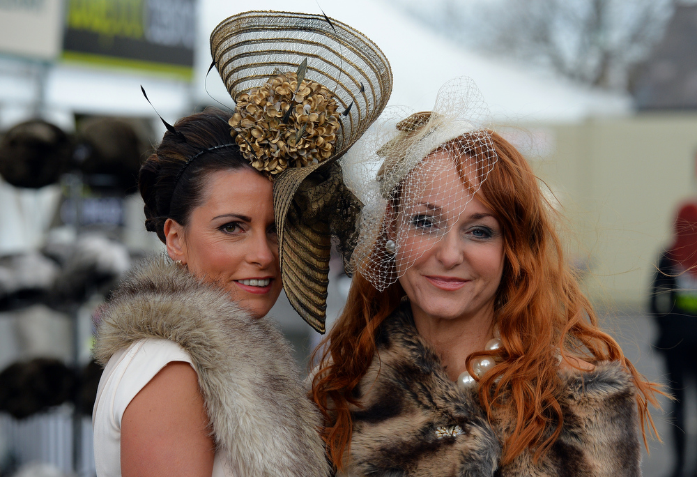 . Racegoers pose as they attend Ladies Day, the second day of the Grand National Meeting horse racing event at Aintree Racecourse in Liverpool, north-west England on April 5, 2013. The annual three day meeting culminates in the Grand National which is run over a distance of four miles and four furlongs (7,242 metres), and is the biggest betting race in the United Kingdom.  ANDREW YATES/AFP/Getty Images