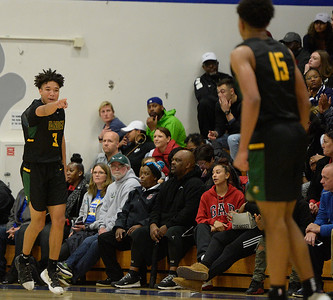 Vanden High boys basketball returns the favor, beats Wood to tie for league lead