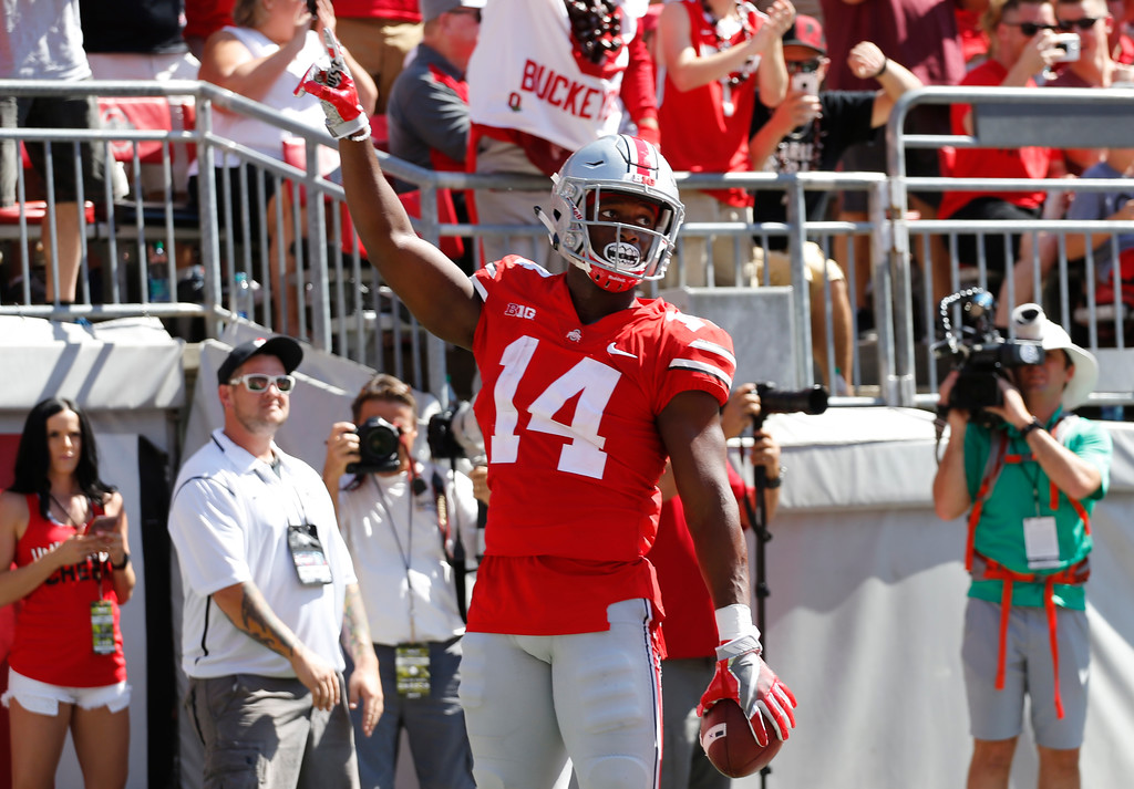 . Ohio State receiver K.J. Hill celebrates his touchdown against UNLV during the first half of an NCAA college football game Saturday, Sept. 23, 2017, in Columbus, Ohio. (AP Photo/Jay LaPrete)