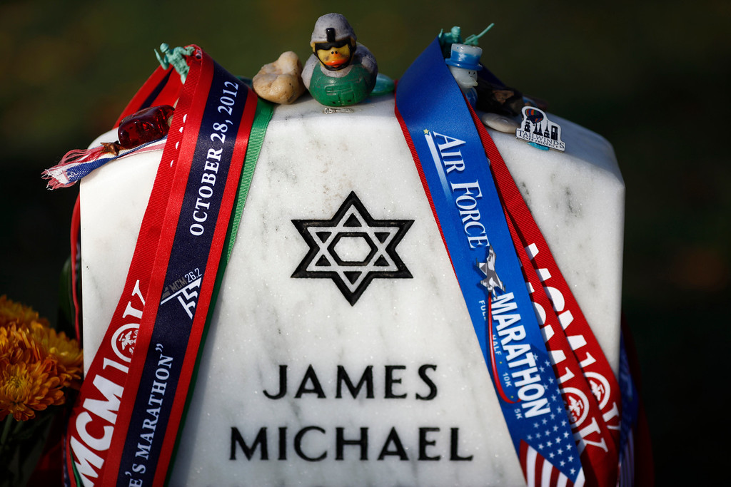 . The gravestone of Marine Staff Sgt. James Michael Malachowski, who died in Marjah, Afghanistan on March 20, 2011, in section 60 of Arlington National Cemetery, on Memorial Day in Arlington, Va., May 28, 2012. (Luke Sharrett/The New York Times)