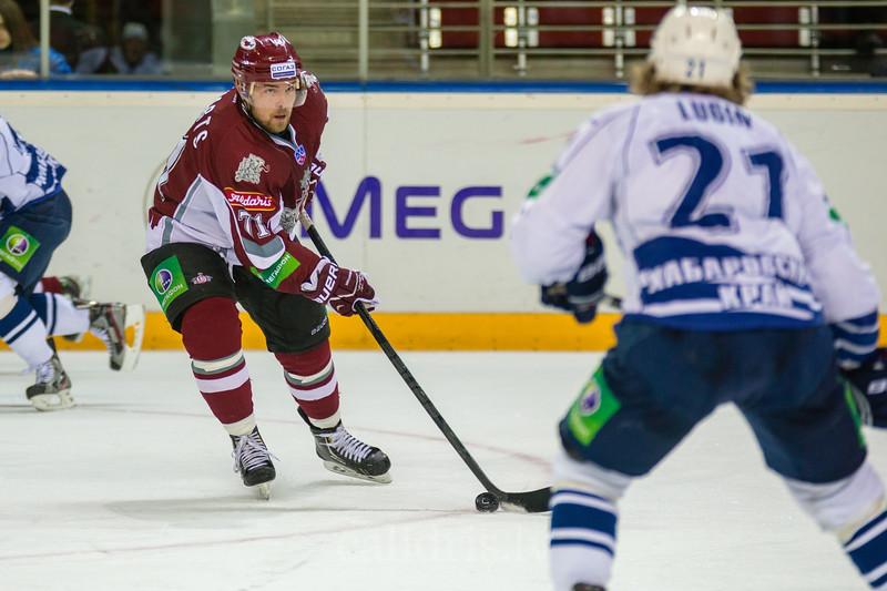 Loginov Alexander (18) stops Andris Dzerins (25) of Dinamo Riga during the first game in final series of Nadezhda Cup between Dinamo Riga and Amur Khabarovsk In Arena Riga
