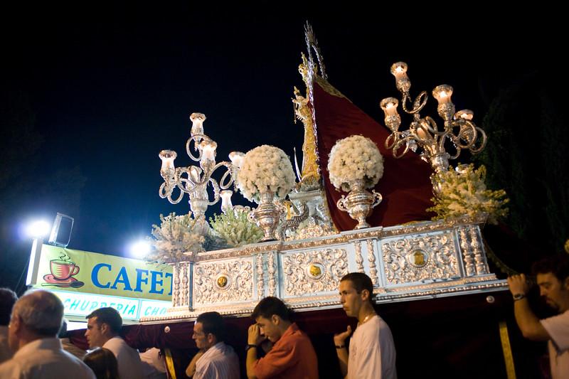 Men bearing a float with the Virgin image, Castilleja del Campo, Spain