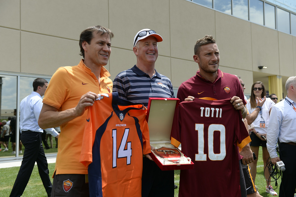 . Manager Rudi Garcia of AS Roma with Denver Broncos head coach John Fox and Francesco Totti exchange gifts at the Denver Broncos 2014 training camp July 25, 2014 at Dove Valley. (Photo by John Leyba/The Denver Post)