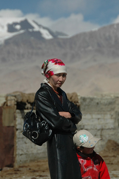 Kyrgyz Mother and Son Waiting Impatiently - Pamir Mountains, Tajikistan