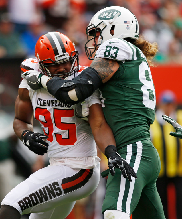. Cleveland Browns defensive end Myles Garrett (95) rushes against New York Jets tight end Eric Tomlinson (83) during the first half of an NFL football game, Sunday, Oct. 8, 2017, in Cleveland. Garrett was able to get to Jets quarterback Josh McCown for the sack on the play. (AP Photo/Ron Schwane)