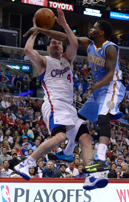 . Clippers#4 J.J. Redick is fouled by Nuggets #09 Aaron Brooks. The Los Angeles Clippers took on the Denver Nuggets in a regular season NBA game. Los Angeles, CA. 4/15/2014(Photo by John McCoy / Los Angeles Daily News)