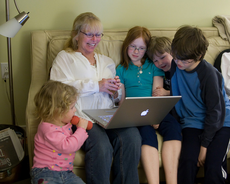 Judi showing Beverly, Madeline, Owen, and Andrew videos