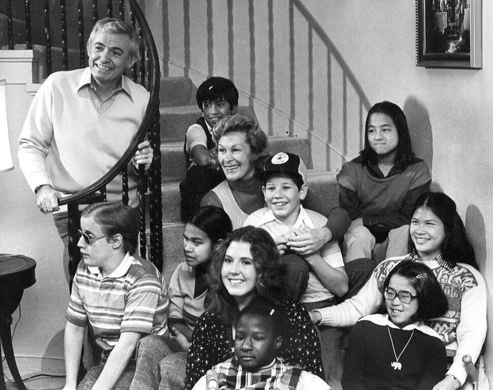 . The DeBolt family has grown again and now includes father Bob Debolt, John Robert, Phong, mother Dorothy, Reynaldo, Twe, Doni, Karen, Sunnee, Ly, and Wendy. (Bill Crouch/Bay Area News Group Archives)