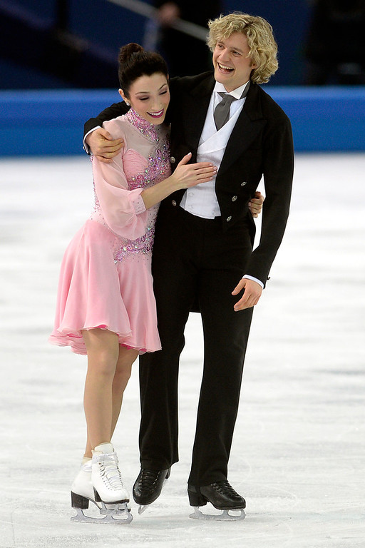 . United States skaters Charlie White and Meryl Davis joke after finishing first in ice dance short with a 75.98 during team figure skating. Sochi 2014 Winter Olympics on Saturday, February 8, 2014. (Photo by AAron Ontiveroz/The Denver Post)