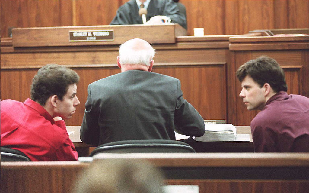 . This February 2, 1995 file photo shows Erik (L) and Lyle (R) Menendez conversing in the courtroom during a hearing in Los Angeles. The Menendez brothers were sentenced to life in prison without the possibility of parole 17 April for the murder of their parents.     (Los Angeles Daily News file photo)