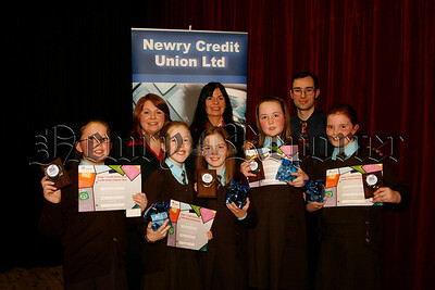 "Abbey Grammer, Credit Union School Quiz,  St Clares ""A"" winners of the U11 Competition with their prizes, Included are from l-r back row, Orla Lynch (education training & marketing officer), Kate Mulholland (education officer) and Philip Killen (education director), 07W5N52"