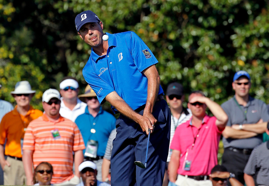 . Matt Kuchar chips to the 17th green during the third round of the Masters golf tournament Saturday, April 12, 2014, in Augusta, Ga. (AP Photo/David J. Phillip)