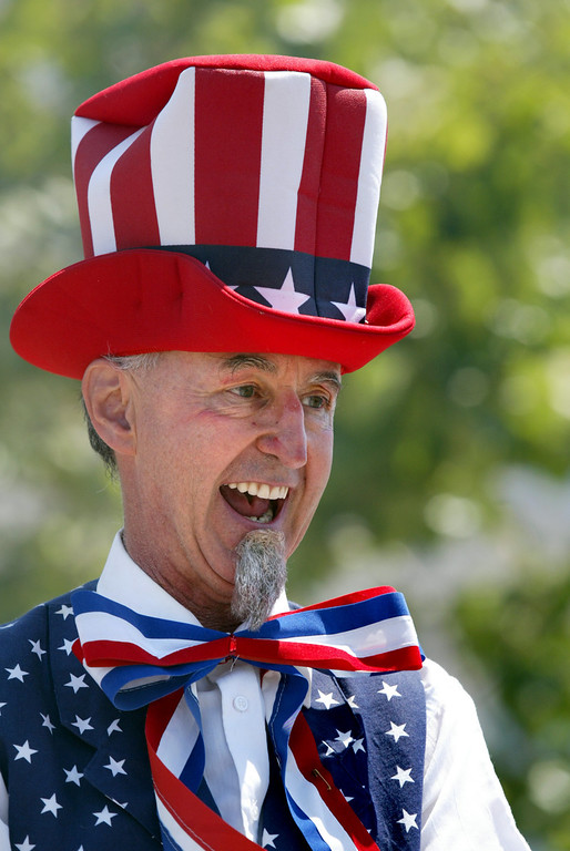 . Drew Letchworth, of El Cerrito, entertains the crowd as Uncle Sam on walking stilts as they celebrate Independence Day at Jack London Square in Oakland, Calif., on Thursday, July 4, 2013.  (Ray Chavez/Bay Area News Group)