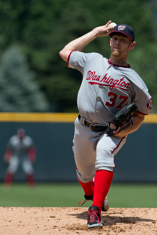 . DENVER, CO - JULY 23:  Starting pitcher Stephen Strasburg #37 of the Washington Nationals delivers to home plate during the first inning against the Colorado Rockies at Coors Field on July 23, 2014 in Denver, Colorado. (Photo by Justin Edmonds/Getty Images)