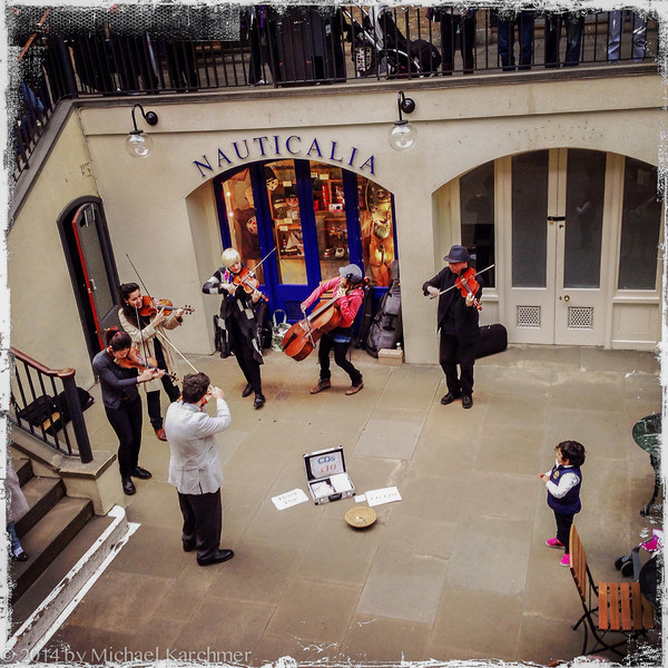 Little girl enthralled by string group, Covent Garden, London (May, 2014)